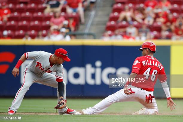 Mason Williams of the Cincinnati Reds steals second base ahead of the tag by Cesar Hernandez of the Philadelphia Phillies in the eighth inning at...