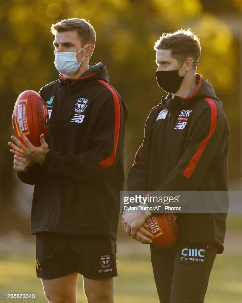 Mason Wood, Conditioning and fitness of the Saints and Nick Dal Santo, Senior Coach of the Saints are seen during the St Kilda training session at...