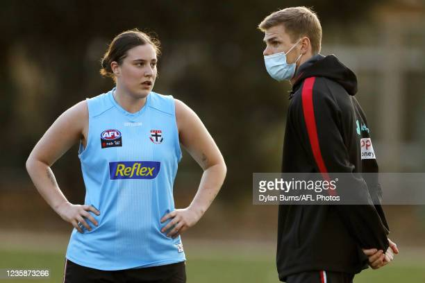 Mason Wood, Conditioning and fitness of the Saints speaks with Caitlin Greiser of the Saints during the St Kilda training session at RSEA Park on...