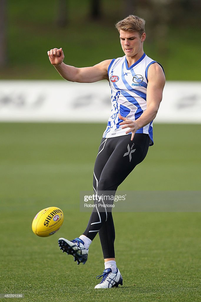 Mason Wood kicks during a North Melbourne Kangaroos AFL media session at Arden Street Ground on July 16, 2014 in Melbourne, Australia.