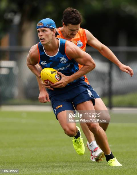 Mason Wood of the Kangaroos in action during a North Melbourne Kangaroos Training Session at Arden Street Ground on January 15 2018 in Melbourne...