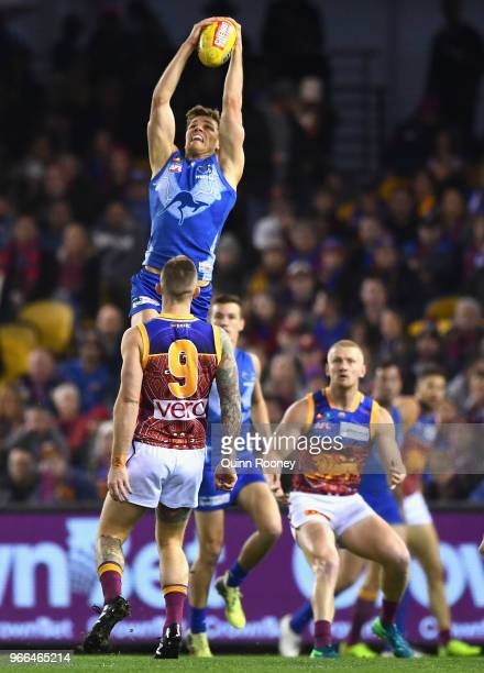 Mason Wood of the Kangaroos marks during the round 11 AFL match between the North Melbourne Kangaroos and the Brisbane Lions at Etihad Stadium on...