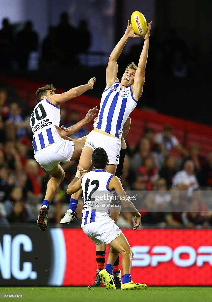 Mason Wood of the Kangaroos takes a mark and then hits his head on the ground and is injured during the round eight AFL match between the Essendon Bombers and the North Melbourne Kangaroos at Etihad Stadium on May 14, 2016 in Melbourne, Australia.