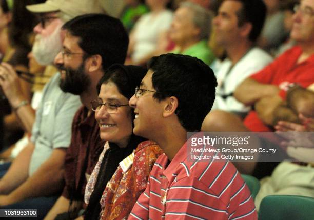 ANGELES Masood Akhtar left Nuzhat Masood center and Ahsan Masood watch Aiman Masood during the opening ceremonies of the The Braille Challenge Finals...