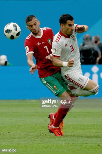 Masoud hojaei of Morocco clashes with Ehsan Haji Safi of Iran during the 2018 FIFA World Cup Russia group B match between Morocco and Iran at Saint...