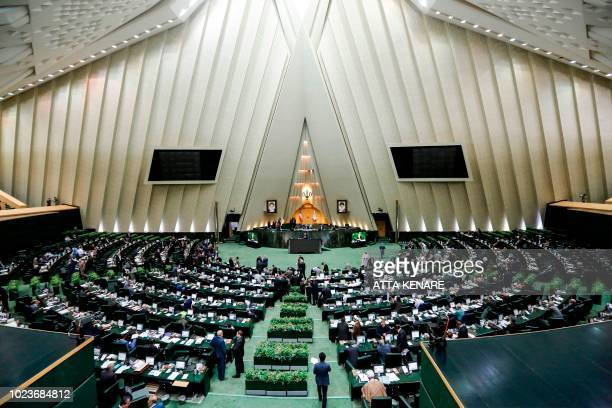 Masoud Karbasian Iran's Economy Minister speaks in parliament in the capital Tehran on August 26 2018 before a vote by lawmakers which saw him...
