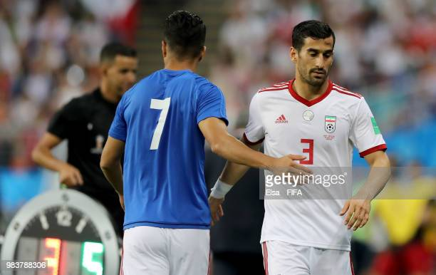 Masoud Shojaei acknowledges Ehsan Haji Safi of Iran as he is substituted during the 2018 FIFA World Cup Russia group B match between Iran and...