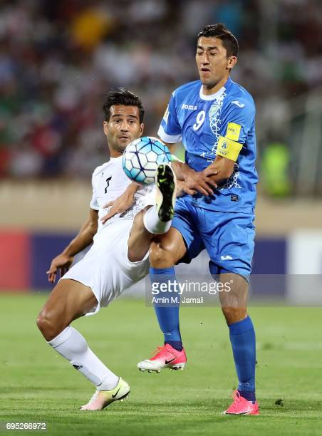 Masoud Shojaei of Iran and Akhmedov Odil Uzbekistan in action during FIFA 2018 World Cup Qualifier match between Iran and Uzbekistan at Azadi Stadium...