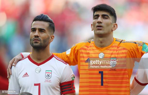Masoud Shojaei of Iran and Ali Beiranvand of Iran sing their national anthem prior to the 2018 FIFA World Cup Russia group B match between Morocco...