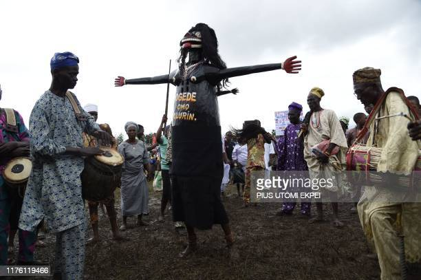 A masquerade dances to drum beats during the IgboOra World Twins festival to celebrate the uniqueness in multiple births at IgboOra Town in Oyo State...