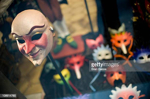 A masquerade mask in a window display