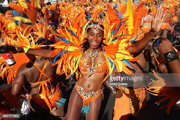 Masqueraders from the band 'Ah Come Back Home' by Ronnie Caro dance in the Queen's Park Savannah during the Parade of Bands as part of Trinidad and...