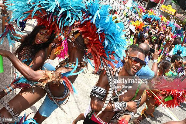 Masqueraders in the band Cirque by Yuma perform during the Carnival Parade at the Trinidad Carnival on March 04 2014 in Port of Spain Trinidad