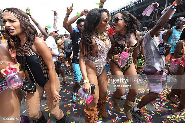 Masqueraders in the band Tribe dance on stage during the Parade of Bands in the Queen's Park Savannah as part of Trinidad and Tobago Carnival on...