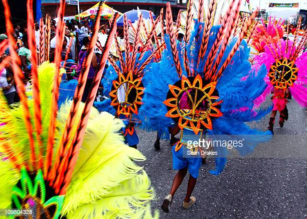 Masqueraders perform at the St James Junior Carnival parade on February 27 2011 in Port of Spain Trinidad