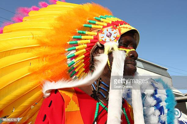 Masqueraders with the band De BOSS dance and party on city streets during Carnival Monday parade of the bands as part of Trinidad and Tobago Carnival...