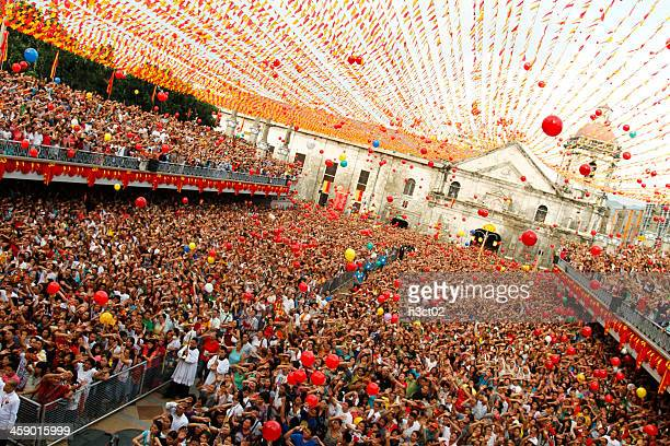 mass at the basilica of santo niño - sinulog festival stock photos and pictures