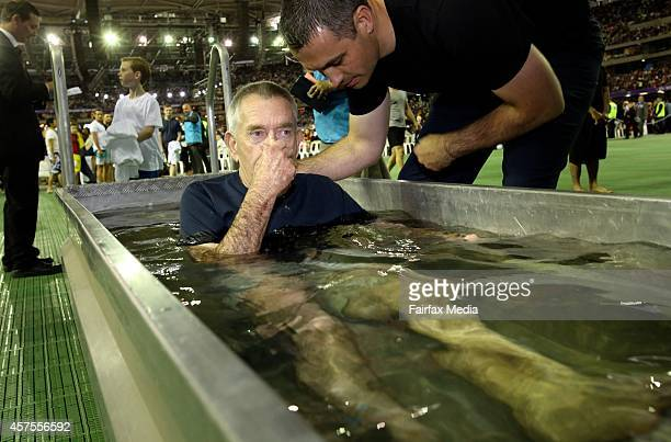 A mass baptism is held at the International Convention of Jehovahs Witnesses at Etihad Stadium in Melbourne October 18 2014 The event attracted...