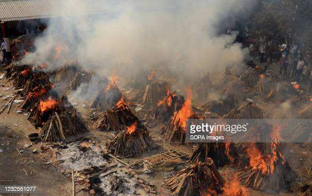 Mass cremation of victims who died due to the coronavirus disease , is seen at Ghazipur cremation ground in New Delhi. In India the highest...