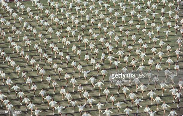 Mass dancers perform on the stadium infield during the opening ceremony for the XXIII Olympic Games on 28 July 1984 at the Los Angeles Memorial...