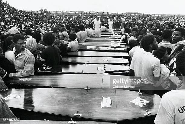 Mass funeral at Kwanobuhle Stadium for victims of the Uitenhage Massacre in the Eastern Cape Province South Africa Two young girls dressed as brides...