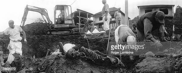 Mass grave containing the bodies of men massacred in Srebrenica in July 1995 is opened and the bodies are exhumed by a team from the ICMP and...
