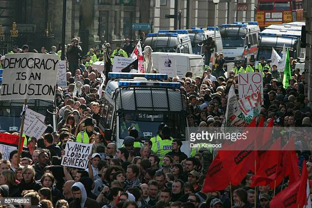 A mass group of anti capitalist and climate change activists converge on the Bank of England as they demonstrate in the City on April 1 2009 in...