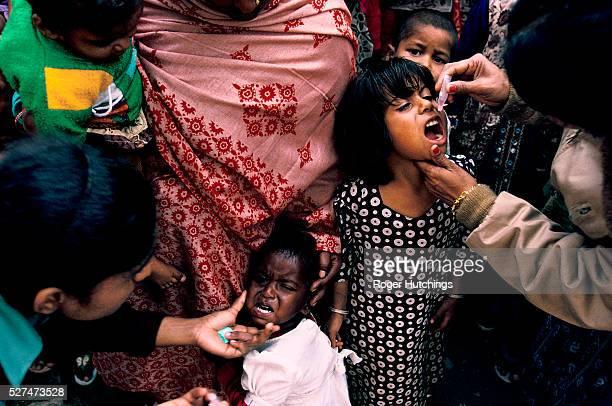 'Mass immunisation of 126 million children in India on one day Polio vaccination for children in the Okhla slum quarter in Delhi'