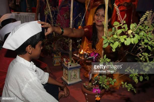 Mass Marriage of Tulsi Vivah celebration at Naralwala Chawl Jamblinaka market organised by Bal Gopal Mitra Mandal on November 2 2017 in Mumbai India...