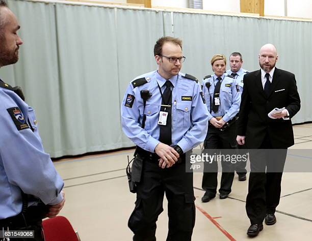 Mass murderer Anders Behring Breivik escorted by police officers enters the courtroom on the third day of the appeal case in Borgarting Court of...