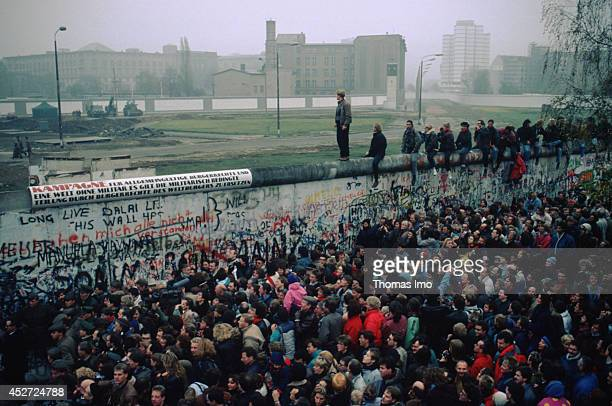 Mass of people in front of the Berlin Wall after opening of the border on November 09 in Berlin Germany The year 2014 marks the 25th anniversary of...