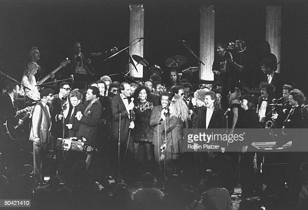 Mass of rock singers & musicians fill the stage as they perform the finale at the Rock & Roll Hall of Fame induction ceremony at the Waldorf-Astoria...