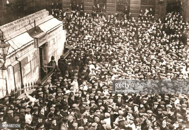 A mass of spectators at the Monument London 18 April 1913 Crowds gathered around the Monument after it had been captured by two suffragettes