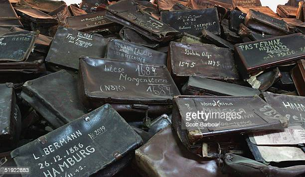 Mass of suitcases removed from men, women and children are seen December 8 displayed at the Auschwitz Concentration Camp Museum in Oswiecim, Poland....