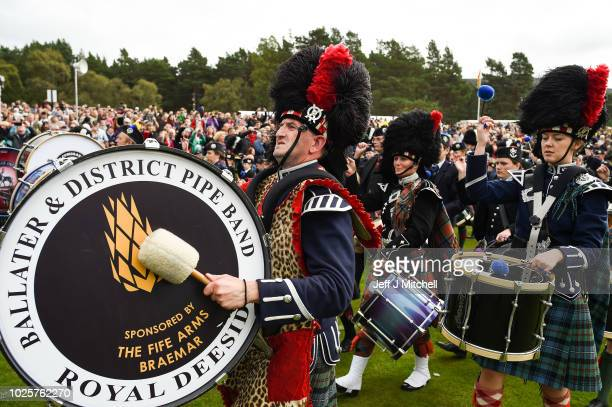 Mass pipe bands play at the annual Braemer Highland Games at The Princess Royal and Duke of Fife Memorial Park on September 1 2018in Braemar Scotland...