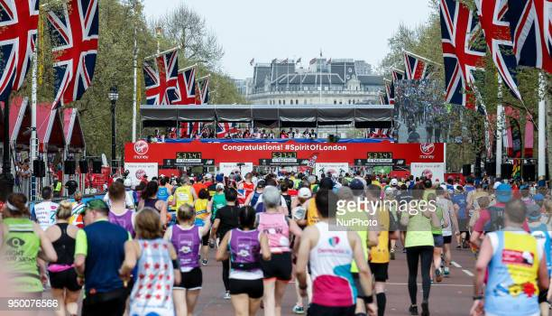 Mass Race runners approach the finish at The Mall during the Virgin Money London Marathon in London England on April 22 2018 41 thousand people...