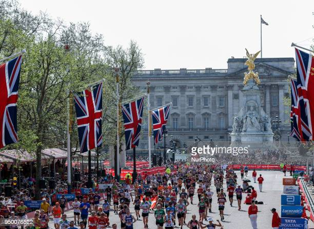 Mass Race runners approach the finish at The Mall in front of Buckingham Palace during the Virgin Money London Marathon in London, England on April...