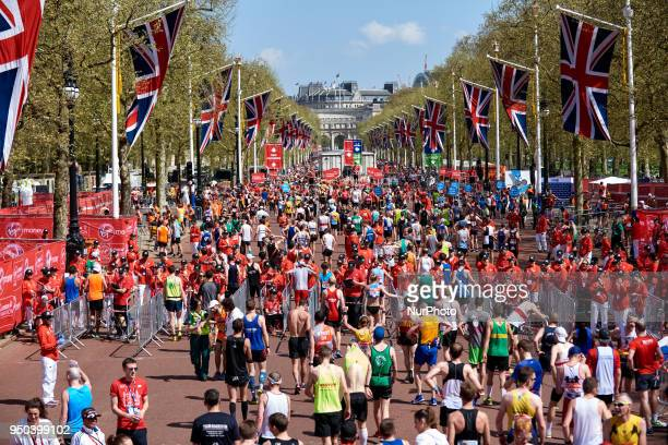 Mass Race runners approach the finish at The Mall in front of Buckingham Palace during the Virgin Money London Marathon in London England on April 22...