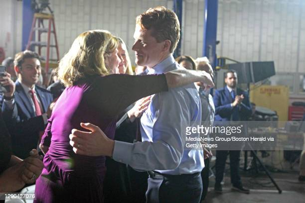 Mass Rep. Joe Kennedy III hug his mom Sheila Brewster Rauch at his rebuttal speech at Diman Vocational School. Tuesday, January 30, 2018.