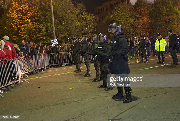 Mass State Police form a perimeter as fans celebrate the Boston Red Sox winning the World Series just outside Fenway Park in Boston MA on October 30