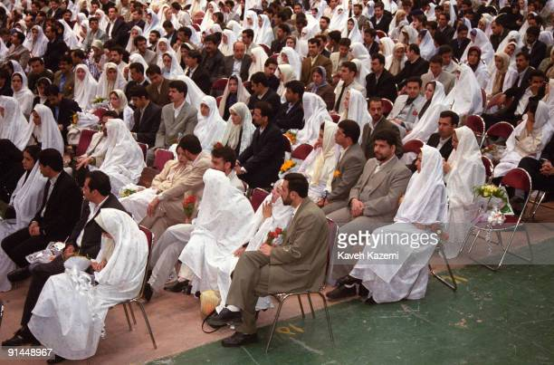 A mass student wedding encouraged by the authorities takes place in the assembly hall at the Ministry of the Interior in Tehran 27th February 2002