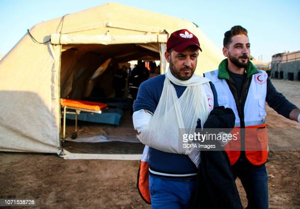 Massaad a paramedic seen helping Ahmed Abdel Bari Abu Foul 35 years old a paramedic working for the Palestine Red Crescent Society who was injured by...