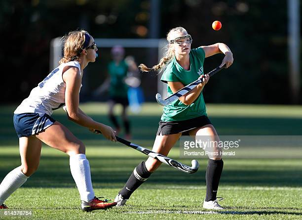 Massabesic's Josie Ring right goes to hit the ball while being guarded by Westbrook's Mary Keef left during the first period of their game Friday Oct...