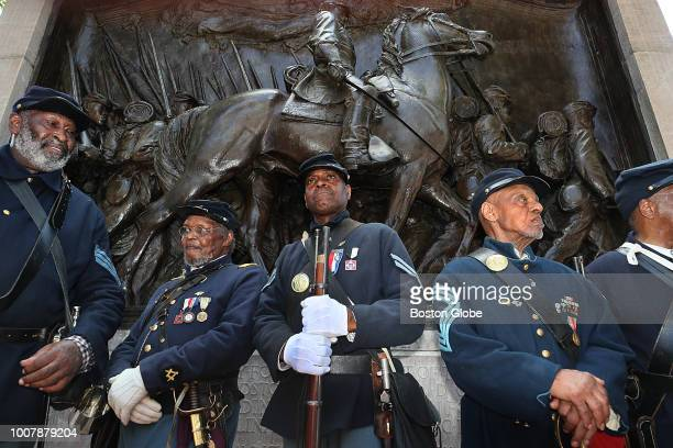 Massachusetts 54th Regiment reenactors pose in front of the Robert Gould Shaw and the Massachusetts 54th Regiment Memorial after an event marking a...