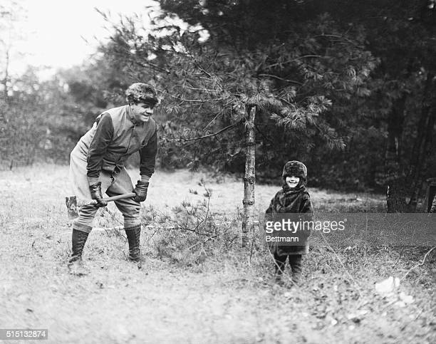 Babe Ruth with daughter Dorothy, now four years old on his farm at Sudbury, Massachusetts.