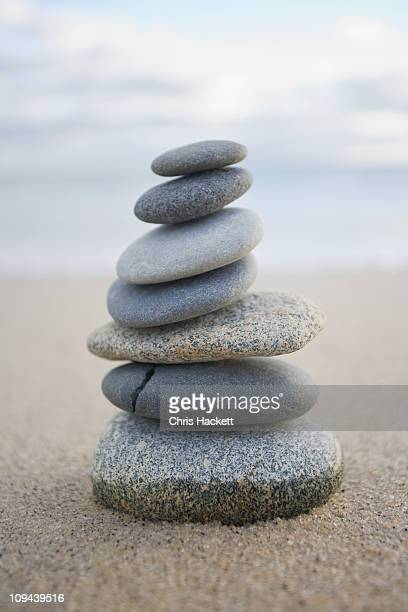 USA, Massachusetts, Beach stones stacked