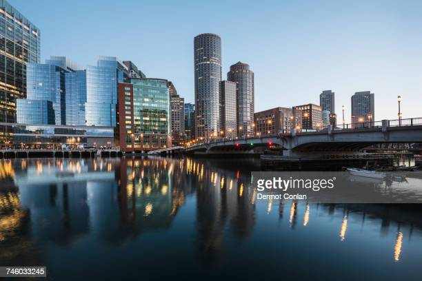 usa, massachusetts, boston, fort point channel, waterfront of financial district at dawn - boston massachusetts stock pictures, royalty-free photos & images