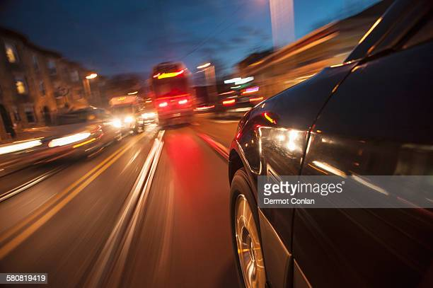 USA, Massachusetts, Boston, Huntington Ave, Car speeding along railroad tracks