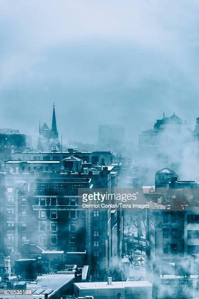 USA, Massachusetts, Boston, Steam above buildings in winter