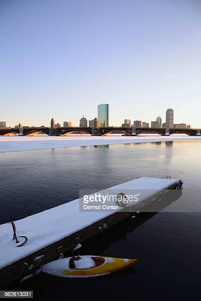 USA, Massachusetts, Boston, View across partially frozen Charles river to Longfellow Bridge and Boston